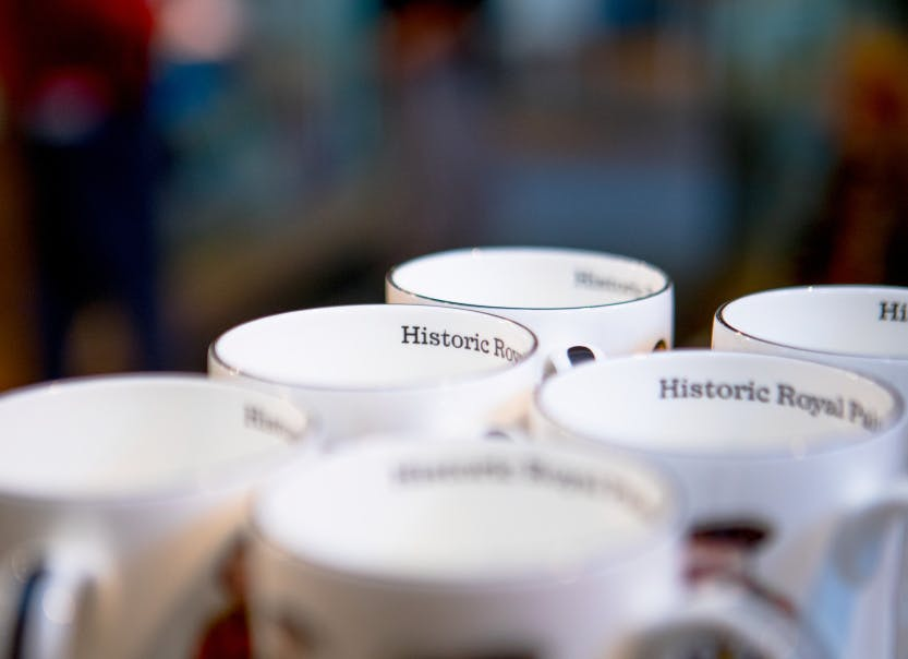 Historic Royal Palace mugs on display in the Palace Shop