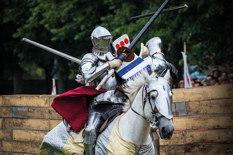 Jousting tournament at Hampton Court Palace, showing two players with lances on horseback