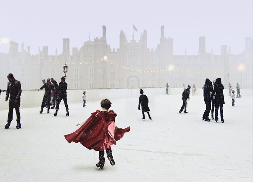 People skate on an ice rink located on the west front outside Hampton Court Palace