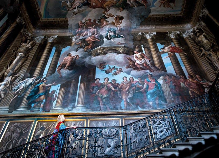 Girl walks up staircase at Hampton Court Palace