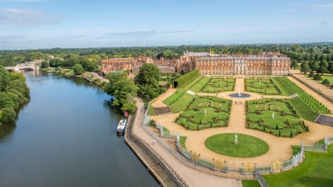 Aerial view of Hampton Court Palace from the river Thames showing Privy Garden, South Front, Pond Gardens