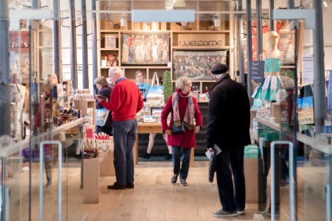 Visitors to Hampton Court Palace browse in the Palace Shop.