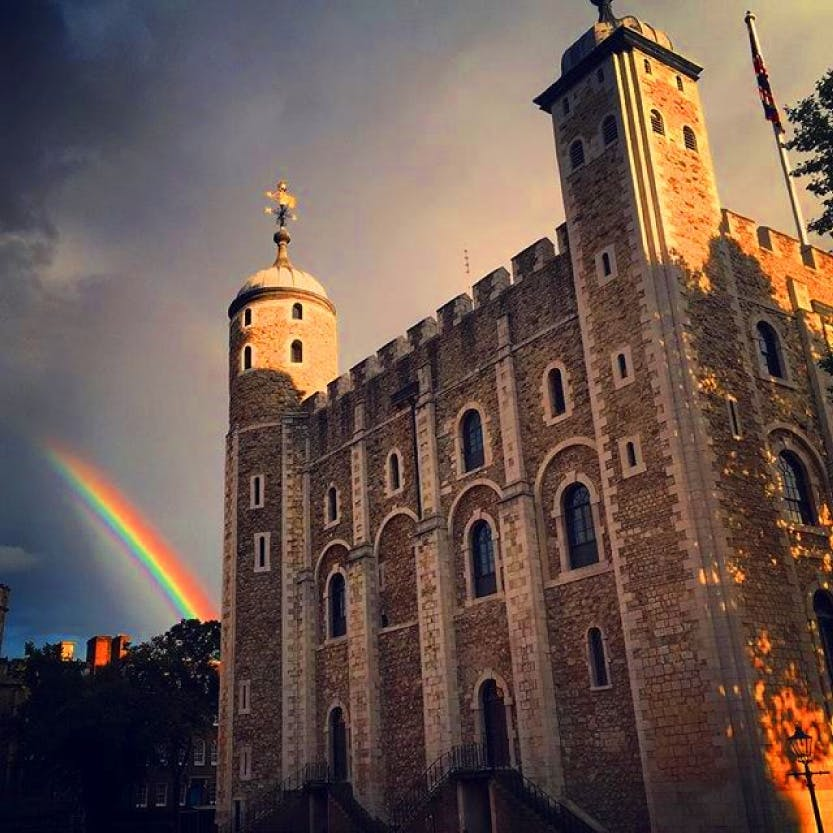 A rainbow appears to the left of the White Tower at the Tower of London