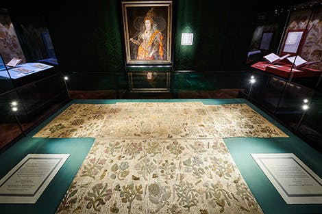 The Lost Dress of Elizabeth I exhibition, showing the Bacton Altar Cloth and the Rainbow Portrait in the green exhibition space.