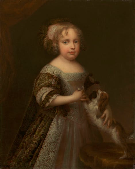 Portrait of Queen Anne as a child when she was a princess.  The Princess is shown fondling a small spaniel which jumps up at her from a table on the right. T
