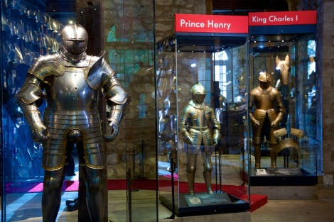 Three suits of armour in cases in the Line of Kings Exhibition in the White Tower of the Tower of London. The two on the left were made for King Henry VIII (as a young boy and as an older man) and the one on the right was made for King Charles I.