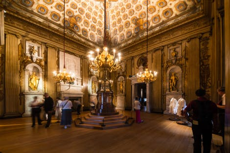 Visitors marvel at the golden interiors of the Cupola Room. The room is filled with golden statues and chandeliers with an old mechanical clock in the centre