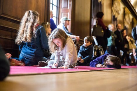 families taking part in hands on activities inside Kensington Palace