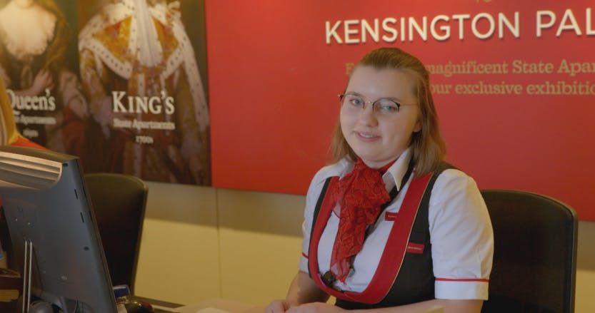 Front of House staff member sitting at ticket desk