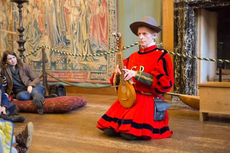 Tudor musician in the Great Watching Chamber at Hampton Court Palace