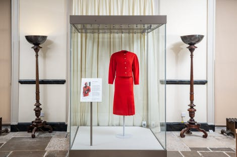 Photographs of Diana, Princess of Wales red Jasper Conran suit for Designing for a Princess exhibition at Kensington Palace.