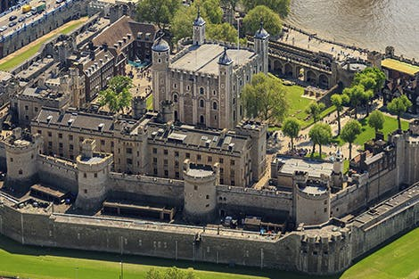 Aerial view of the Tower of London with its inner and outer walls, London Bridge and the River Thames.