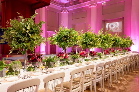 A long dining table set up for guests in Banqueting Hall