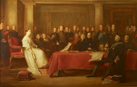 Queen Victoria, dressed in white, is seated in the Red Saloon at Kensington Palace at the head of a table covered with red cloth; she holds a declaration in her right hand and is confronted by her Accession Council; Lord Melbourne stands in the centre.