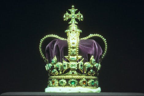 Crown illuminated on a black background