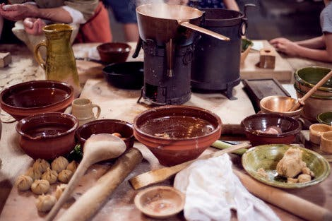 Tudor food is prepared on a table in Henry VIII's Kitchens at Hampton Court Palace
