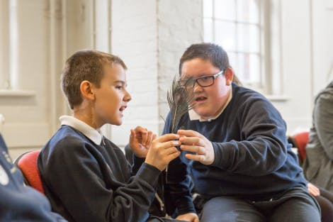 Two students taking part in a school session for Special Educational Needs and Disabilities students
