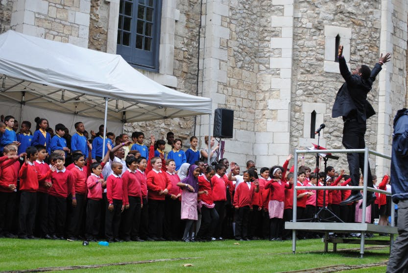 Students singing at the Music at the Tower festival at the Tower of London