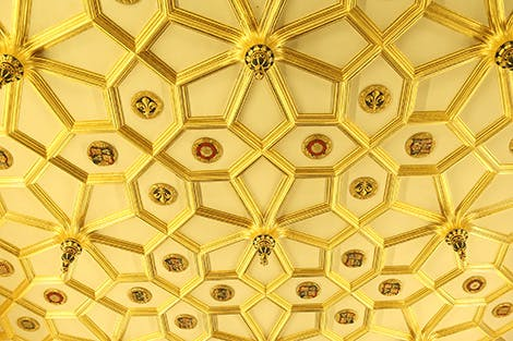 The ceiling of the Great Watching Chamber showing gold decoration and Tudor symbols.