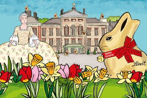 Illustration of the East Front of Kensington Palace with a giant gold Lindt bunny in the foreground. A lady in period dress stands on the left of the image
