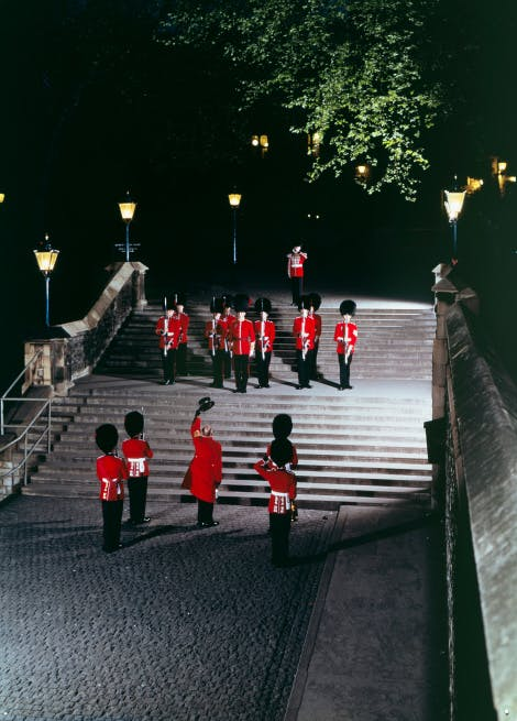 The Ceremony of the Keys, showing the conclusion of the ceremony with the Chief Yeoman Warder saluting the Queen's Guard