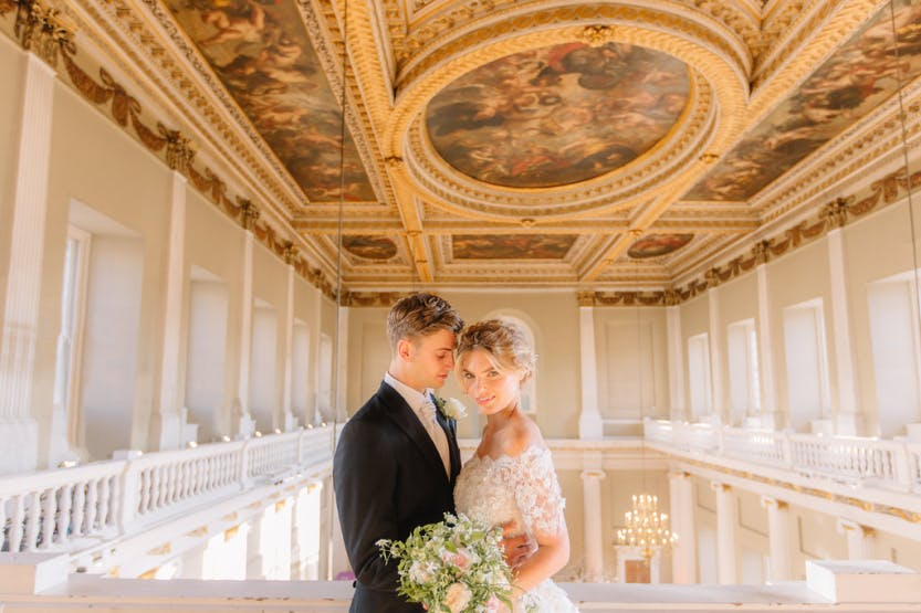 A bride and groom embrace below the Rubens Ceiling of Banqueting House, Whitehall