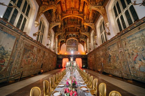 A long table laid out for 60 dinner guests in the historic Great Hall at Hampton Court Palace