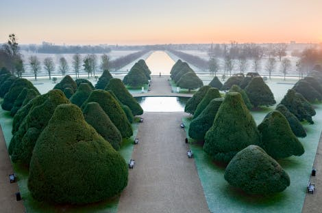 The Great Fountain Garden in winter, looking east from the roof of the palace along the avenue of yew trees to Home Park and the Long Water beyond.