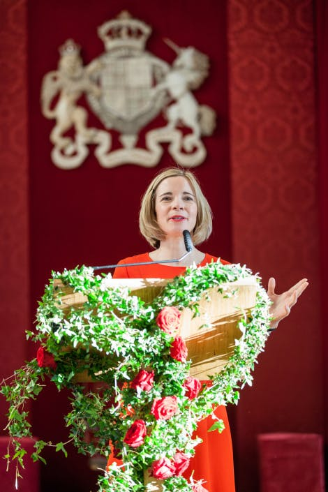 Lucy Worsley giving a speech at the Banqueting House