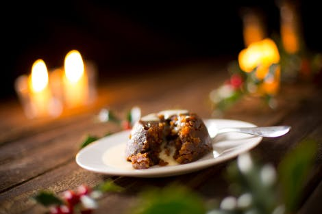 Small Christmas pudding served on a plate