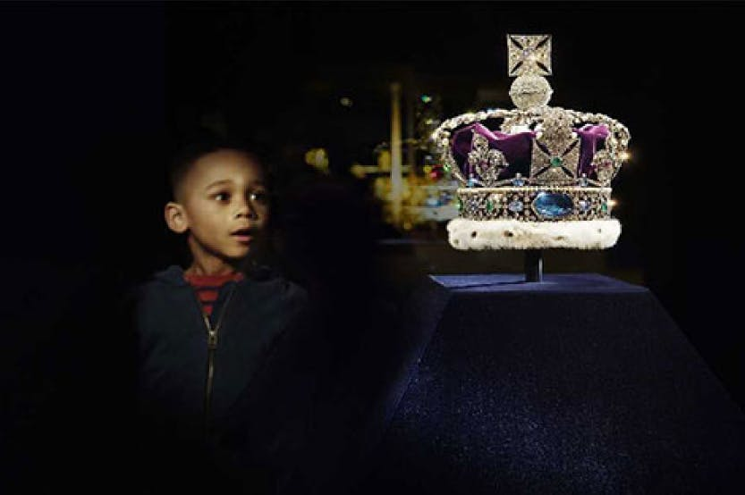 Photo of a child looking at the Crown Jewels