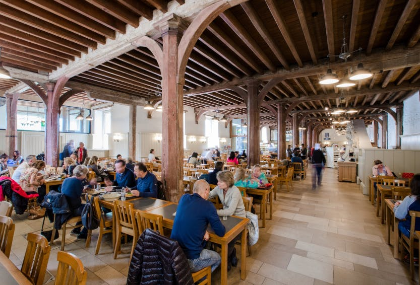 Interior view of the New Armouries Cafe/Restaurant with visitors shown eating and drinking.