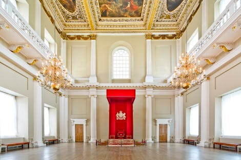 Main Hall at Banqueting House with red canopy of state and the Rubens ceiling showing at one end