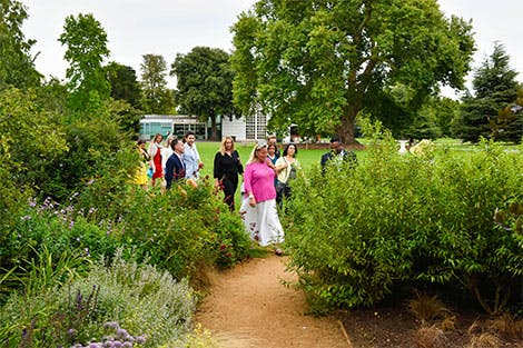 Guests on a tour in the Kitchen Garden.