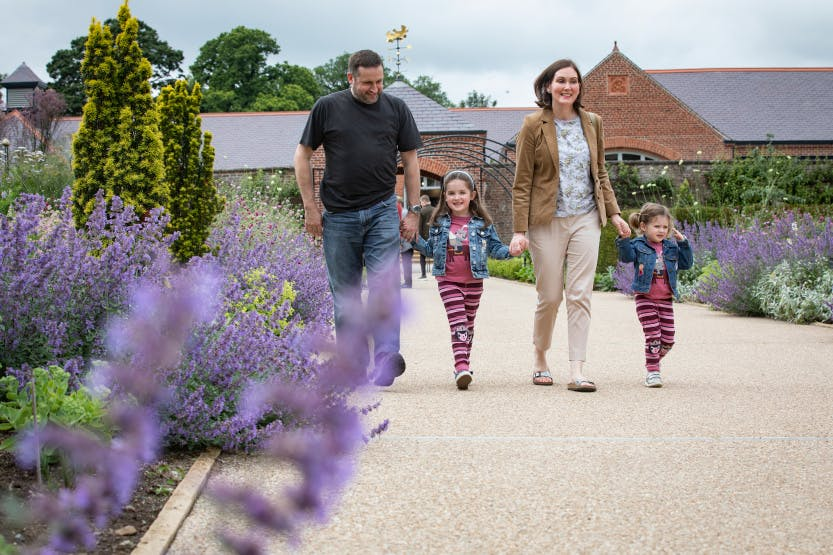 A family enjoy the gardens at Hillsborough Castle and Gardens at the Food Festival.