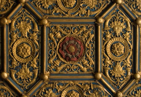 The Wolsey Closet. Detail of the ceiling richly decorated with gilded Renaissance motifs and coloured badges incorporating the Tudor rose
