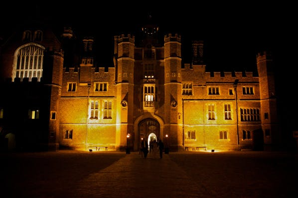 Base Court of Hampton Court Palace illuminated in the darkness