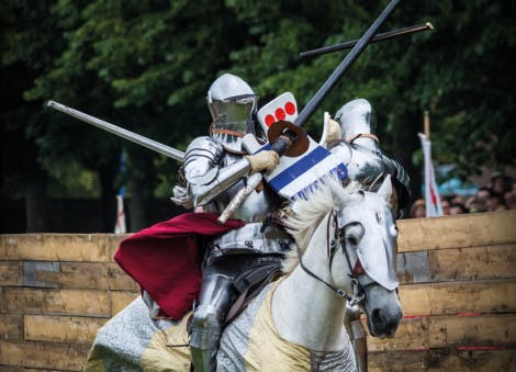 A knight with a joust on the back of a horse at Hampton Court Palace