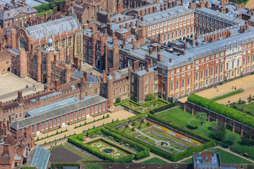 Aerial view of Hampton Court Palace from the south west, showing the Pond Gardens in the foreground.