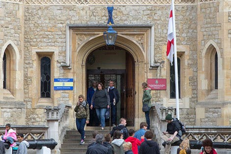 Visitors enter the stone facade of The Fusilier Museum at the Tower of London