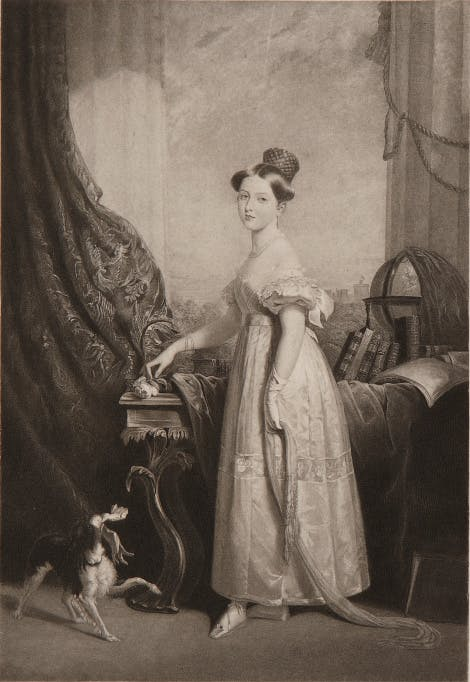 Princess Victoria with her spaniel, Dash. The Princess is wearing evening dress, holding a rose, near a table with books and a globe