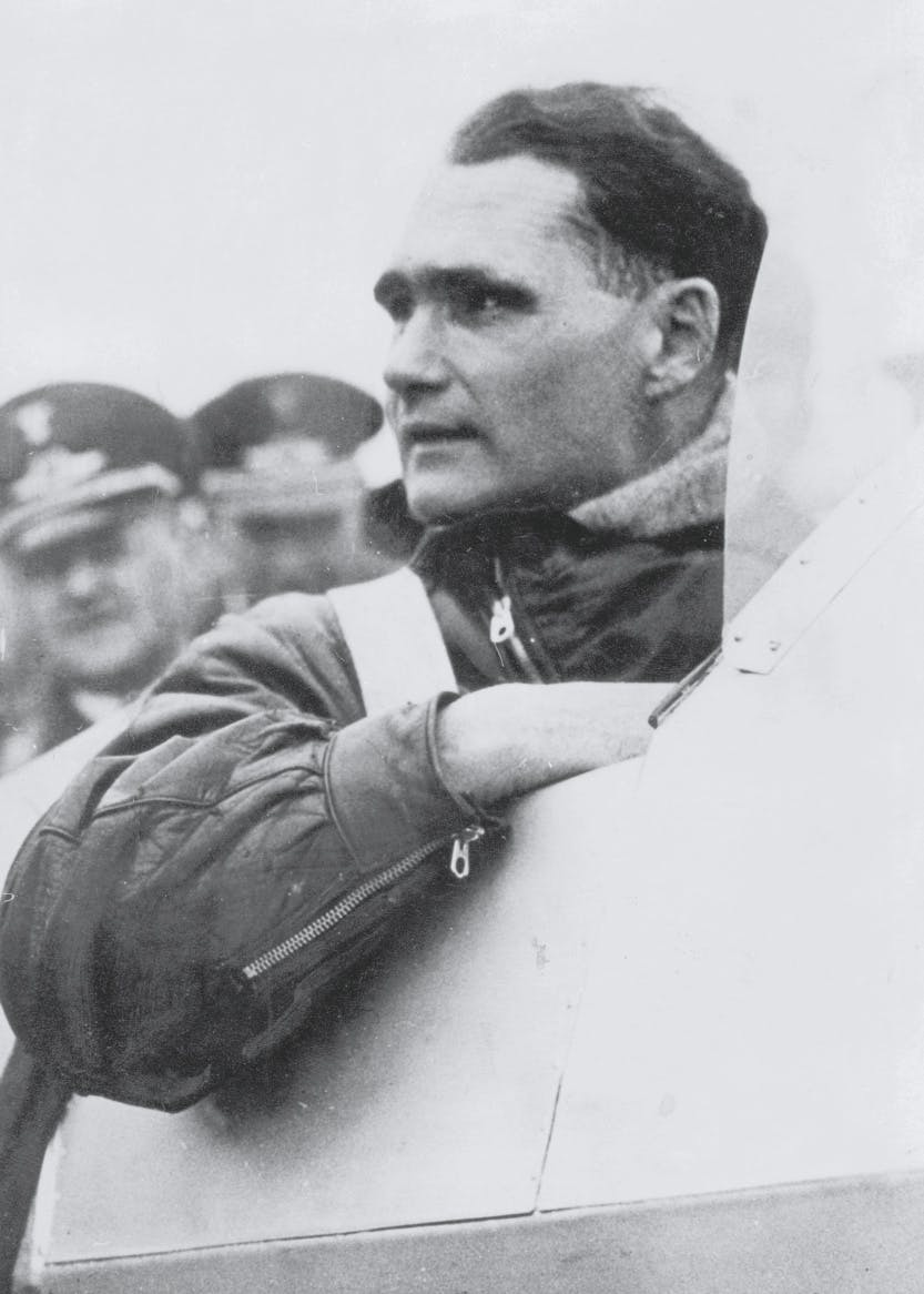 Black and white photograph of Rudolf Hess, deputy to Adolf Hitler, inside an airplane.
