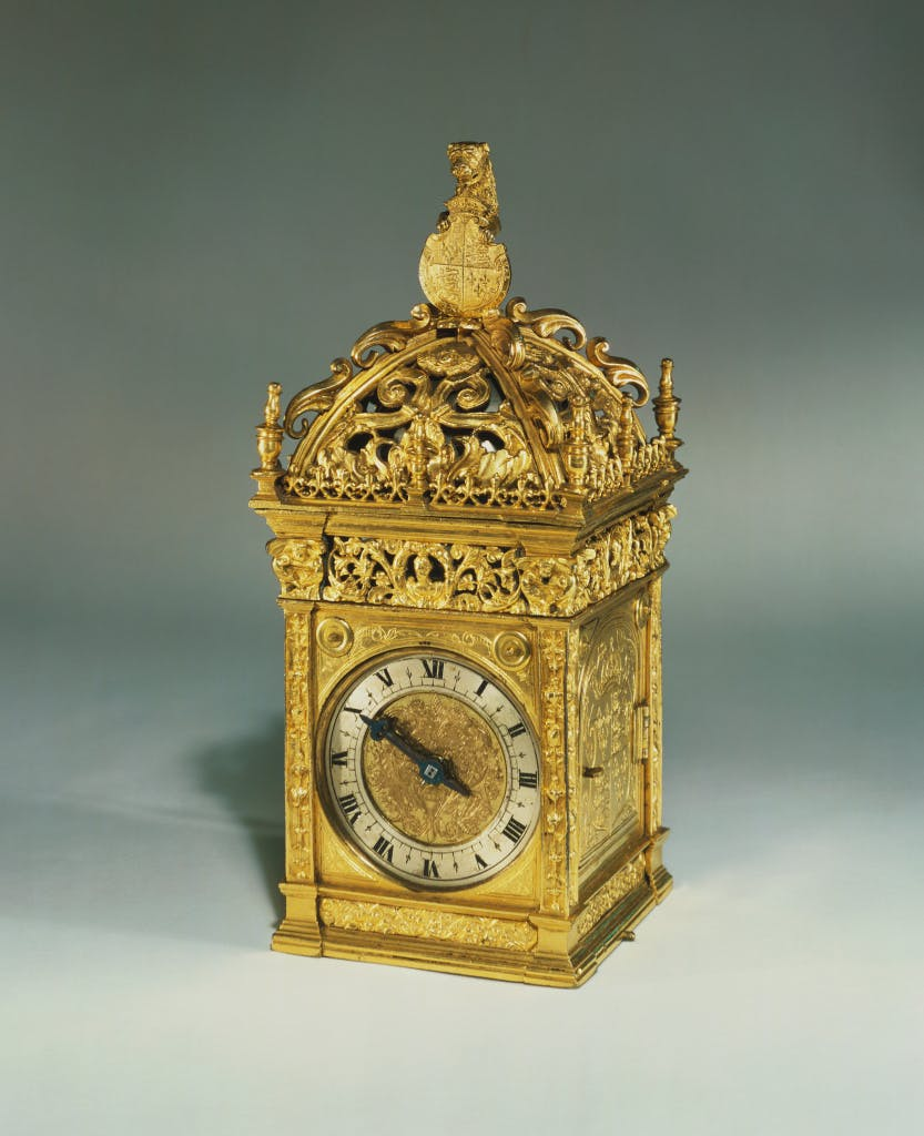 An image of a gilt-bronze wall hung clock, reputed to  have been given by King Henry VIII to Anne Boleyn on the morning of their marriage in 1532.