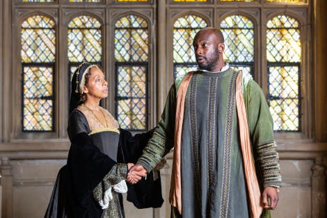 Encounters with the Past acting company play courtiers in the Great Hall at Hampton Court Palace