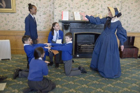 Children in a school session in Queen Victoria's bedroom at Kensington Palace