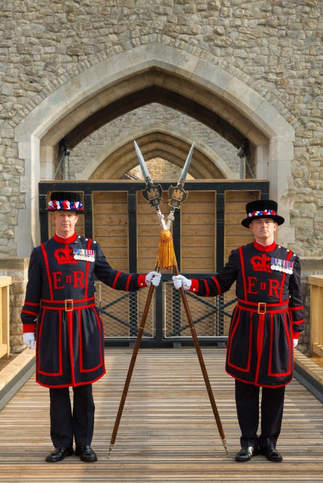 Two Yeoman Warders, dressed in their uniform, guarding the Middle Drawbridge.