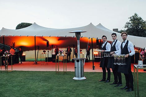 Waiters outside a reception 10x15 tent on west Orangery Lawn, September 2016