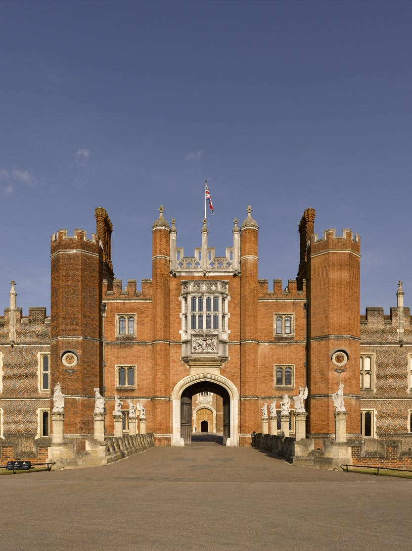 Hampton Court Palace Tudor west gate, shown under a blue sky