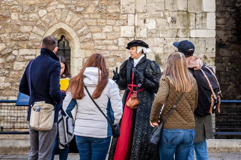 Teachers listen to a costumed historic interpreter as part of a site familiarisation during a continuing professional development day at the Tower of London.