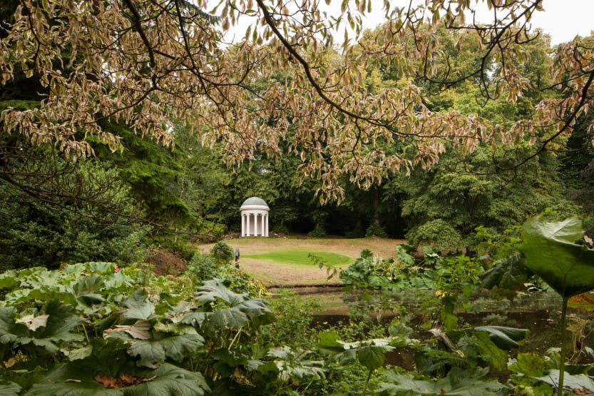 Hillsborough Castle Gardens, looking across a pond towards Lady Alice's Temple.